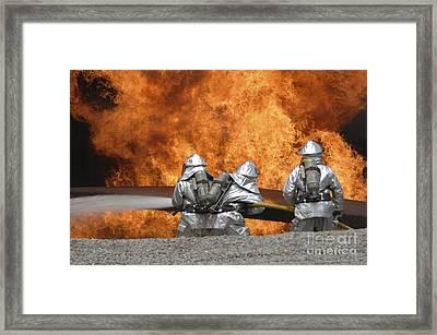 Firemen Neutralize A Fire Framed Print