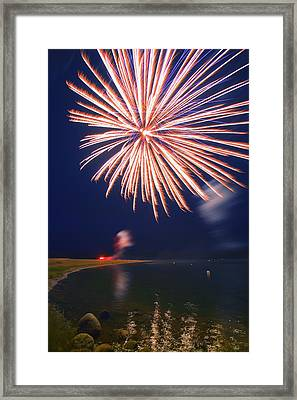 Fireworks Over A Body Of Water Framed Print by Carson Ganci