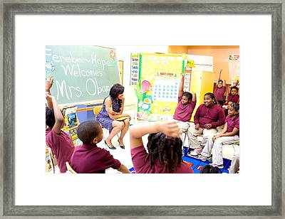 First Lady Michelle Obama Chats Framed Print by Everett