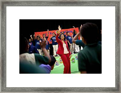 First Lady Michelle Obama Exercises Framed Print