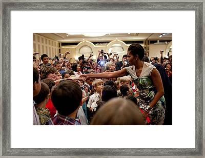 First Lady Michelle Obama Greets Framed Print