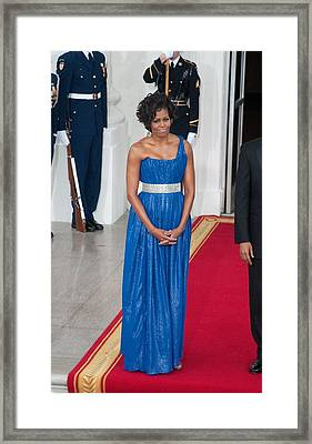 First Lady Michelle Obama Wearing Framed Print