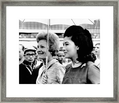 First Lady Pat Nixon Left And Imelda Framed Print by Everett