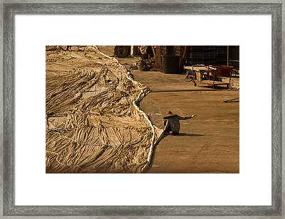 Fisherman Sewing Net Framed Print