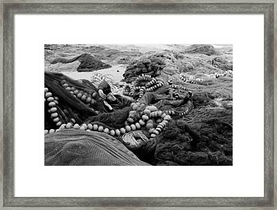 Framed Print featuring the photograph Fisherman Sleeping On A Huge Array Of Nets by Tom Wurl