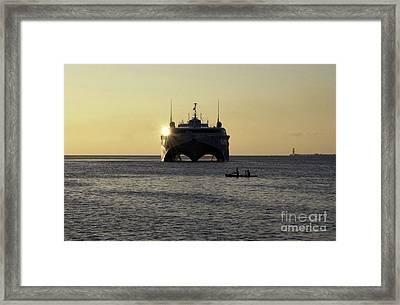 Fishermen Paddle Their Canoe Framed Print by Stocktrek Images