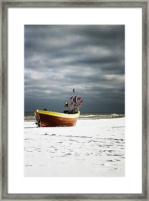 Framed Print featuring the photograph Fishermen's Boat On Snowy Beach by Agnieszka Kubica