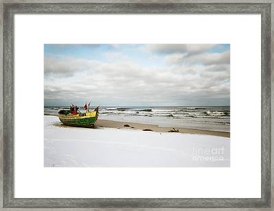 Framed Print featuring the photograph Fishermen's Boat Waiting On A Beach by Agnieszka Kubica