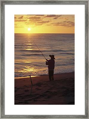 Fishing At Sunrise Framed Print by Raymond Gehman