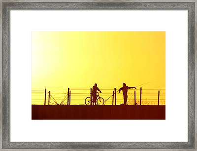 Fishing At Sunset Framed Print by Dennis Pintoski
