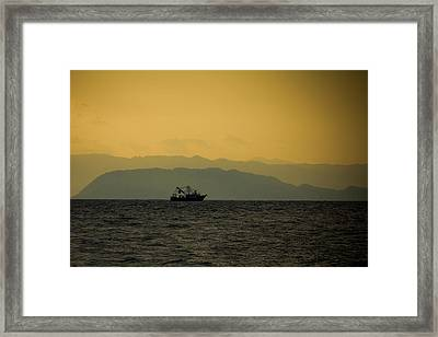 Fishing Boat At Sunset Framed Print by Anthony Doudt