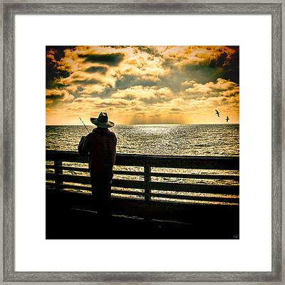 Fishing On A California Pier Framed Print by Chris Lord