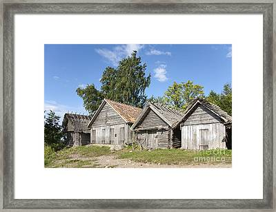 Fishing Sheds Framed Print by Jaak Nilson