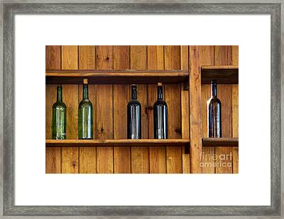 Five Bottles Framed Print by Carlos Caetano