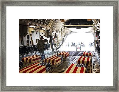 Flag Draped Coffins Of Five Us Soldiers Framed Print by Everett
