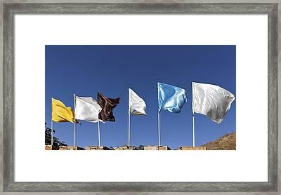 Flags Fluttering Against Blue Sky Framed Print by Kantilal Patel