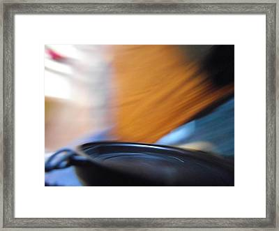 Flash In A Pan Framed Print