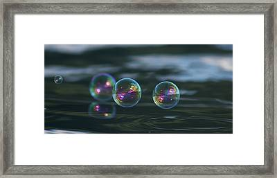 Framed Print featuring the photograph Floating Bubbles by Cathie Douglas