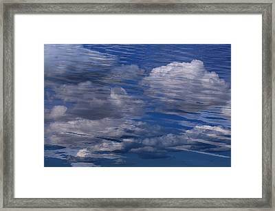 Floating Clouds Framed Print by Michael Mogensen