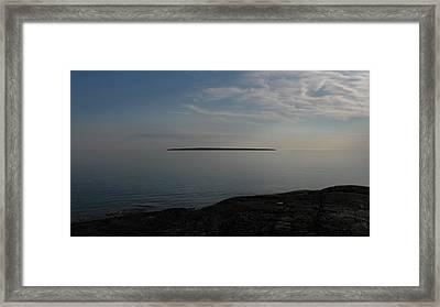 Floating Island Framed Print by Waldemar Okon