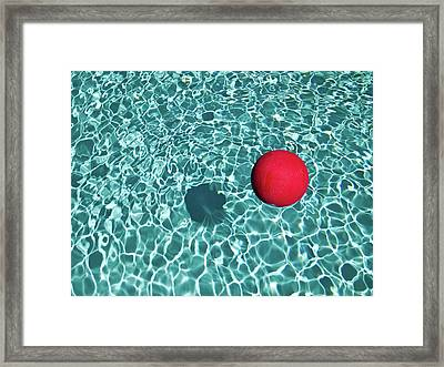 Floating Red Ball In Blue Rippled Water Framed Print