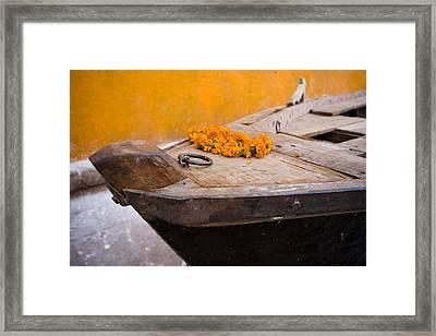 Flowers On Top Of Wooden Canoe Framed Print by David DuChemin