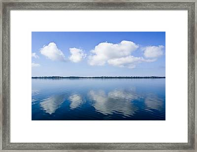 Fluffy Clouds Float Over A Perfectly Framed Print by Jason Edwards