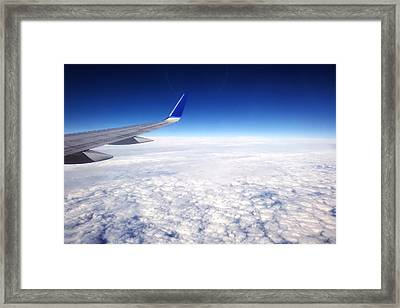 Flying Above The Clouds Framed Print