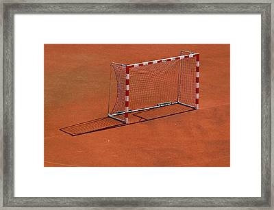 Football Net On Red Ground Framed Print by Daniel Kulinski