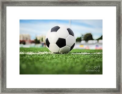 Football On Green Grass   Framed Print by Mongkol Chakritthakool