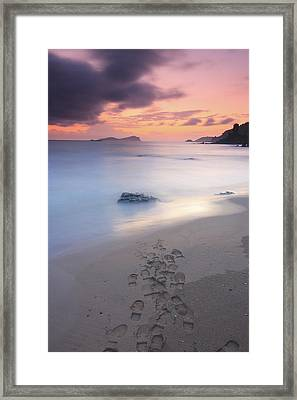 Footprints On Beach At Sunset Framed Print by Oscar Gonzalez