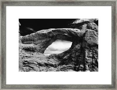 Foreboding Rock Formation Framed Print by Richard Elkins