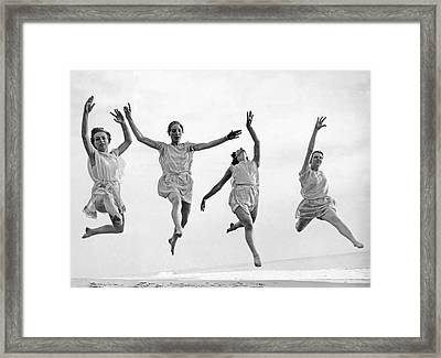 Four Dancers Leaping Framed Print by Underwood Archives