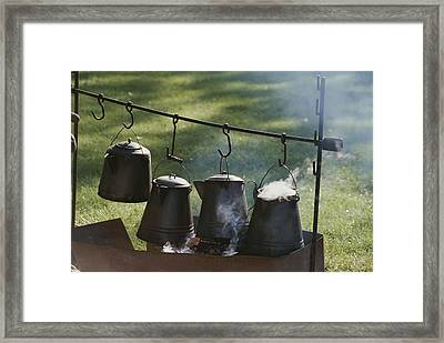 Four Metal Coffee Pots Steaming Over An Framed Print by Michael S. Lewis