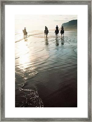 Four People Horseback Riding On A Framed Print
