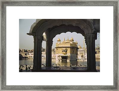 Framed By The Arch Of A Small Pavilion Framed Print by Maynard Owen Williams