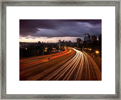 Freeway Lights At Dawn Framed Print by John Clutterbuck
