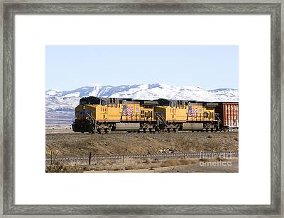 Freight Train East Of Boise Framed Print by David R Frazier and Photo Researchers