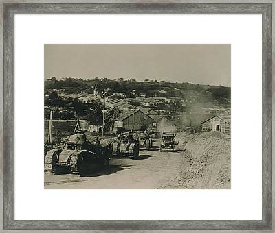 French Tanks Passing Through Rampont Framed Print by Everett
