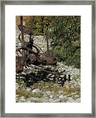Front Half Of Old Plow Framed Print by Ernie Echols