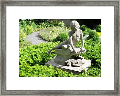 Frozen At Play Framed Print by Nicola Nobile