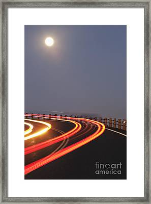 Full Moon Over A Curving Road Framed Print
