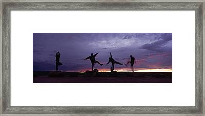 Funny Poses, Yoga And Sunset Framed Print by Bill Hatcher