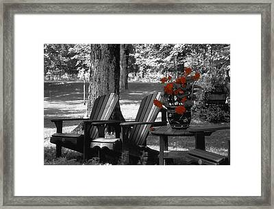 Garden Chairs With Red Flowers In A Pot Framed Print by David Chapman
