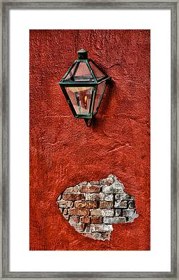 Gaslight On A Red Wall Framed Print