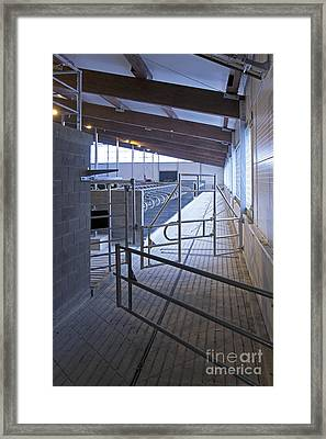 Gated Railing In A Cowshed Framed Print