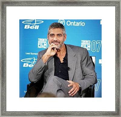 George Clooney At The Press Conference Framed Print by Everett