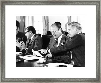 Gerald Ford At A Cabinet Meeting Framed Print by Everett