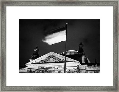 german flag flying fluttering on flagpole outside reichstag building Berlin Germany Framed Print by Joe Fox