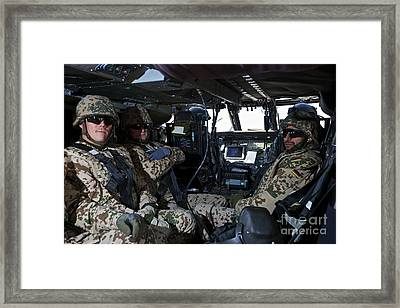 German Soldiers Seated In A Uh-60l Framed Print by Terry Moore
